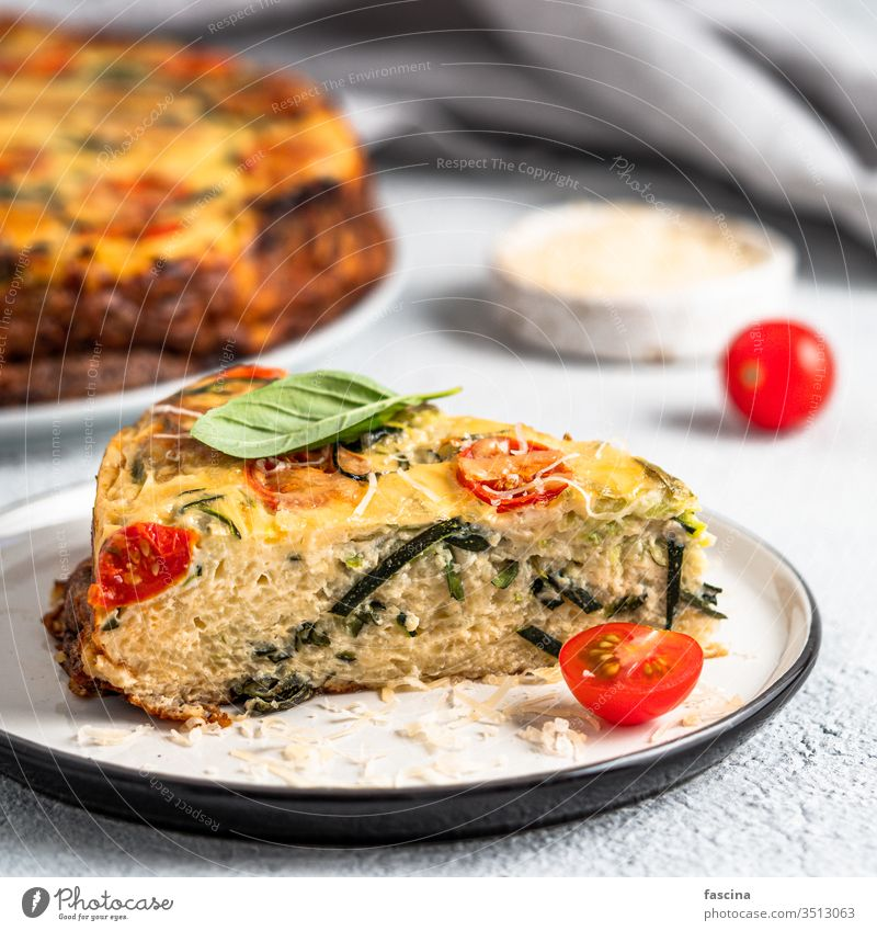 Piece of zucchini pie, copy space right recipe piece harvest homemade lot basil herb concept idea cement baking healthy cheese tomatoes savory delicious
