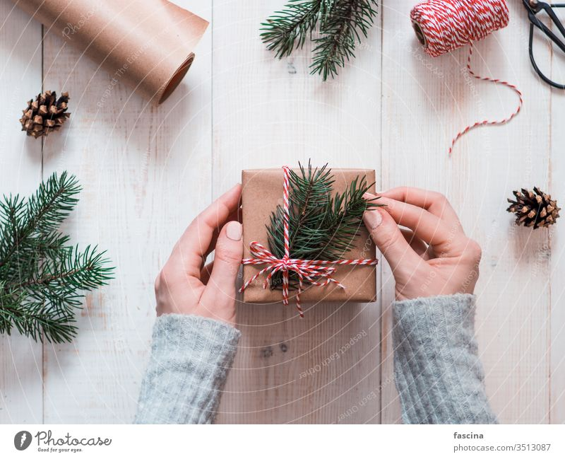 Woman packing presents for Christmas in boxes female hands vintage table holiday christmas woman hygge people wrapped december decor copyspace merry packaging