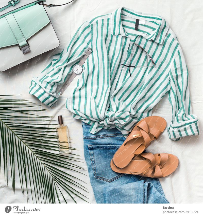 Female fashion clothes flat lay, square flatlay slippers feminine summer composition striped blouse bag sunglasses watch perfume jeans palm leaf white