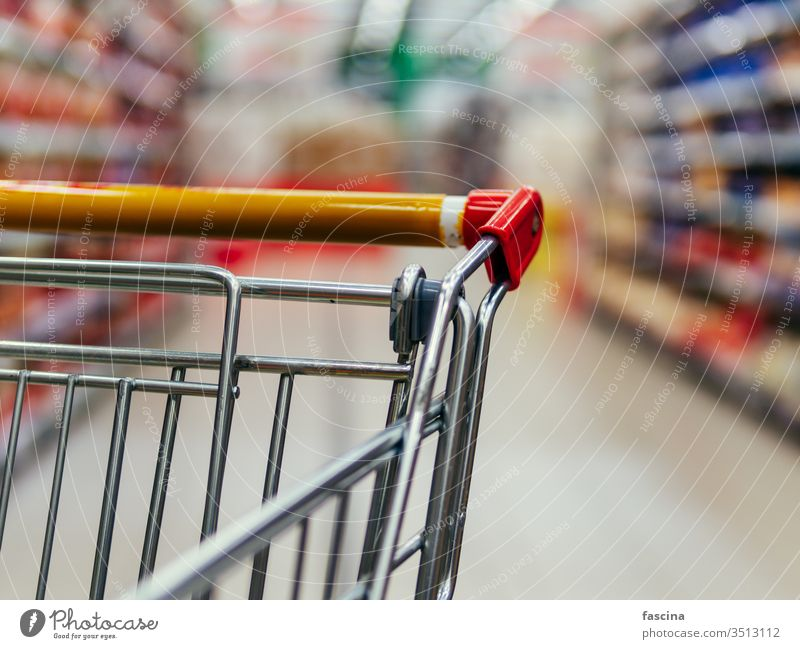 shopping trolley in supermarket aisle, copy space grocery cart food store retail shelf customer hypermarket consumer consumerism goods background buy commerce