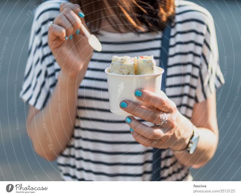 Hand holding rolled ice cream in cone cup icecream iced hand woman baked fruit fry copy space background ice-cream summer dairy delicious dessert food freshness