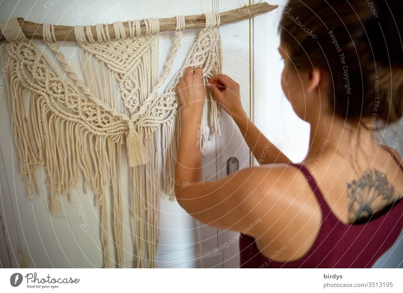 Young woman creatively engaged in macramé work at home stay home Macramé Creativity Handcrafts active stay at home Employment ideas Productive Knot knot