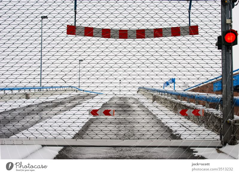 closed car park in the snow Winter Winter mood Frost Cold Gate red traffic light Closed Highway ramp (entrance) Parking garage lane Reflector Twilight