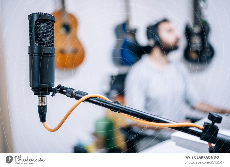 Microphone in recording studio. microphone male guitars studio recording artist audio back digital composer entertainment computer headphone hobby instrument
