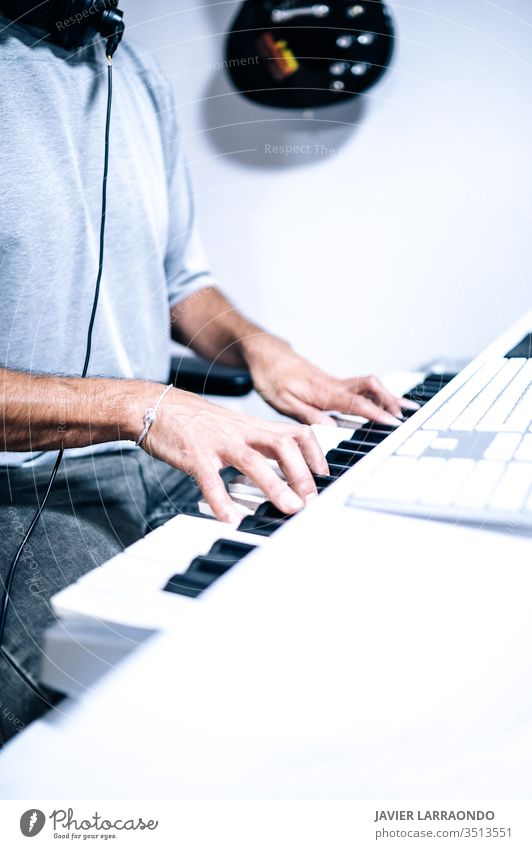 Musician playing piano desk midi artist audio equipment digital composer entertainment computer headphone instrument keyboard listening live music backgrounds