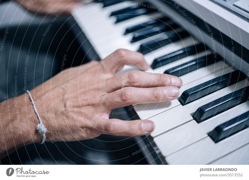 Hands playing a midi keyboard in a music studio hands musician artist audio digital composer entertainment guitar guitarist hobby instrument listening live
