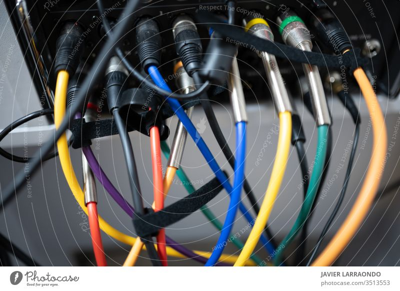 Various colored sound cables connected equipment colorful connectors artist audio back band electricity digital composer entertainment computer hobby instrument