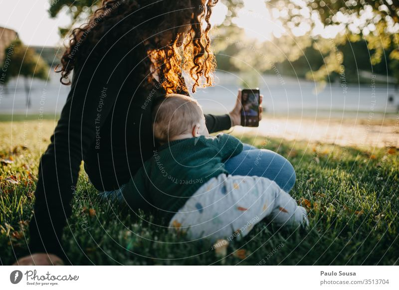 Mother and baby taking selfie photo Technology smartphone Selfie taking photo Together Lifestyle Joy Smiling Exterior shot Telephone Woman Happy Summer