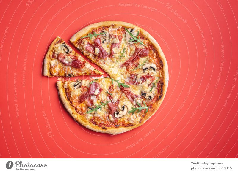 Ham pizza homemade. Pizza top view on a red background. above view arugula bakery champignons cheese comfort food crust cuisine cut out delicious dinner