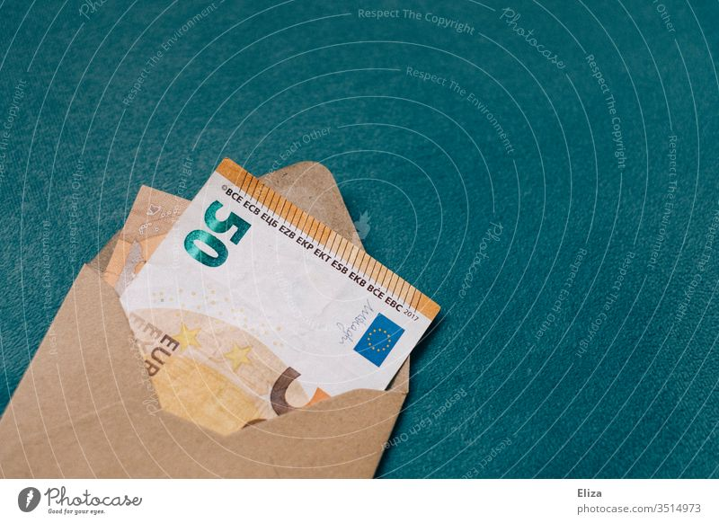 A brown envelope with a bank note inside Bank note Money Envelope 50s 50 euros Euro pretence Gift Donate Donation Invoice Mail Interior shot Save Deserted