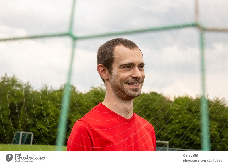 Portrait from Sportsman portrait head soccer player sport football goal sportsman champions grass game competition winner net smile smiling sporting person