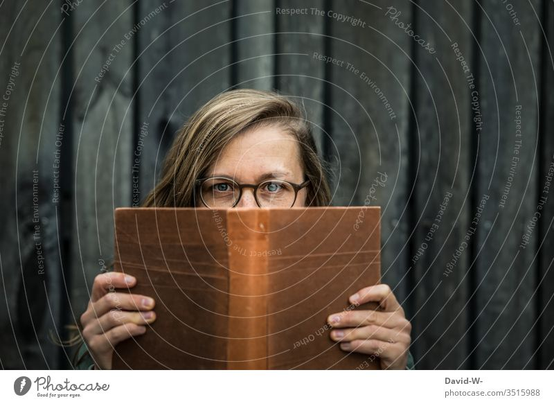 person young woman with glasses reading a book Woman Reading Book Nostalgia nostalgically Eyeglasses Tension Novel Person wearing glasses Young woman Student
