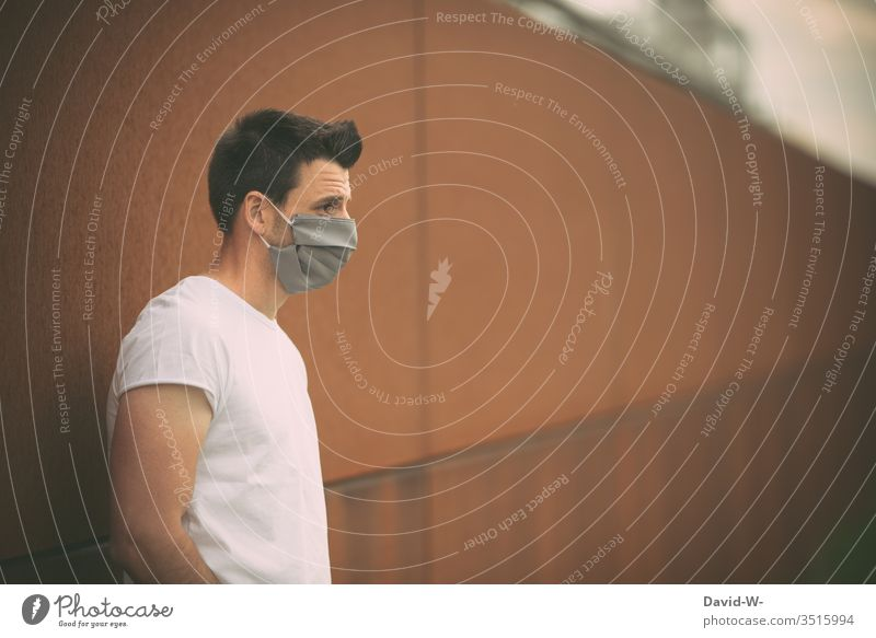 Man with breathing mask Respirator mask coronavirus Virus Self-made Mask Illness Healthy pandemic Protection Contagious Epidemic Sick Quarantine COVID Infection