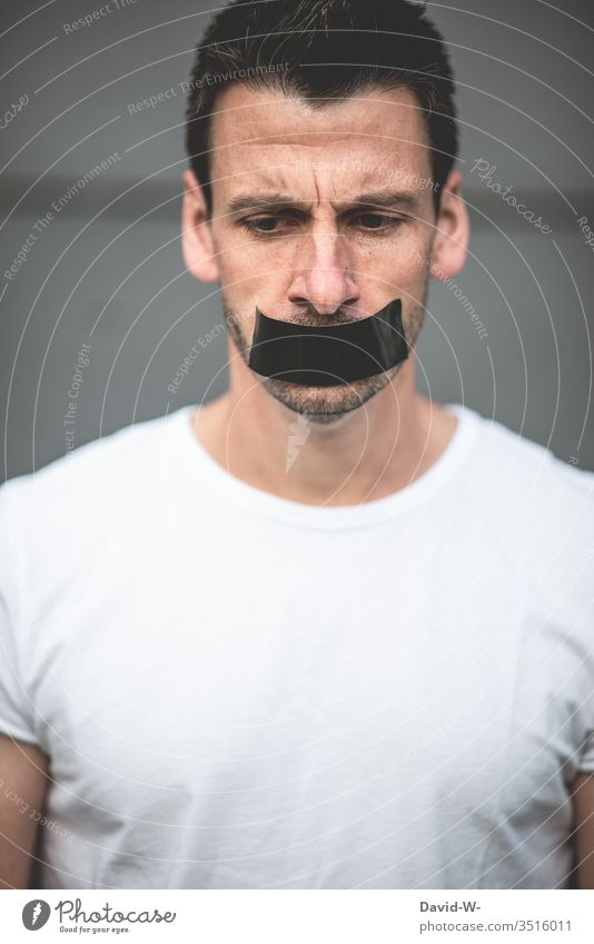 Prohibition to speak - man mouth glued shut Muzzle Mouth pasted up gag Adhesive tape Silent Fall silent Bans Calm Fear Freedom of expression free