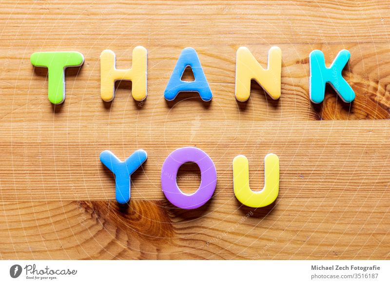 Thank You words written with colorful letters on wooden background Hand Handwriting abstract appreciate appreciation business card concept conceptual customer