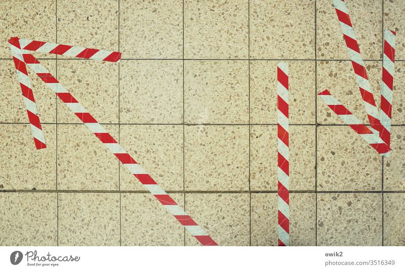 Crisis Management Under Floors Tile Adhesive tape Reddish white Striped Arrow Clue Direction groundbreaking Change in direction Decide Muddled Which way?