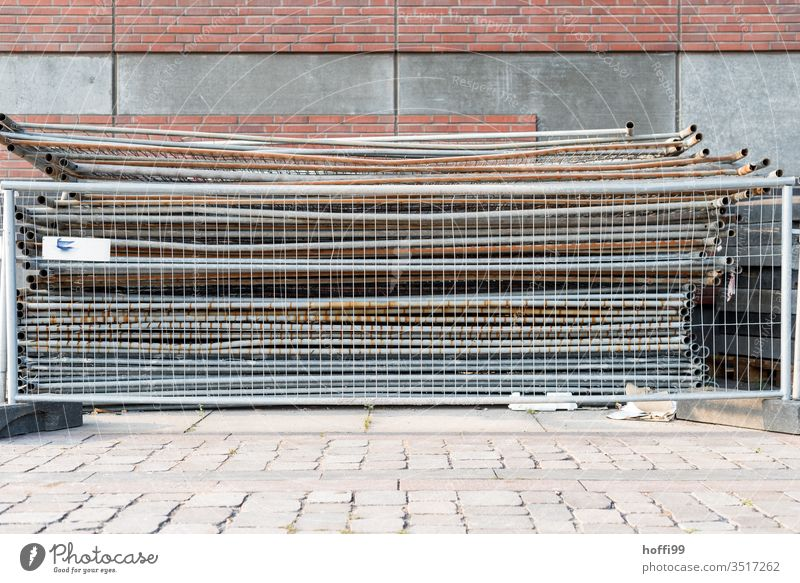 Stacked crush barriers behind crush barriers lattice fence Construction site Grating Barrier Metal Fences Metalware Safety Protection cordon