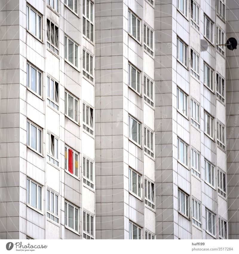 derelict outer facade of a residential building House (Residential Structure) Balcony Flag Threat Contrast Cliche Dry Hideous Fear of the future Stress Dirty