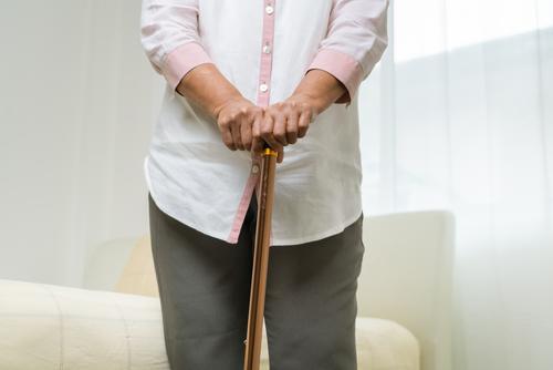 Knee pain of senior woman with stick, healthcare problem of senior concept ache aged arthritis body bone caucasian discomfort disease doctor elderly emotional