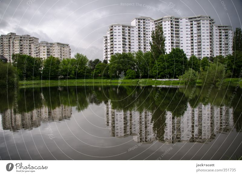 Strange quarter Water Sky Clouds Climate change Bad weather Pond Tower block Facade Sharp-edged great Tall Modern Town Moody Agreed Calm Gloomy Idyll
