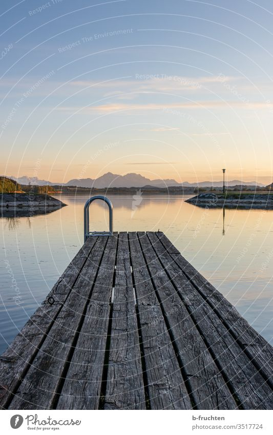 Small wooden jetty at the lake Sunset Dusk evening mood Clouds Sky Horizon Twilight Evening Landscape Nature Lake Footbridge Alps Austria Calm Water Deserted