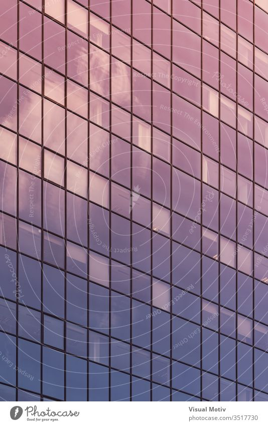 Afternoon lights reflected on the glass facade of an office building abstract abstract background abstract photography afternoon apartment architectonic