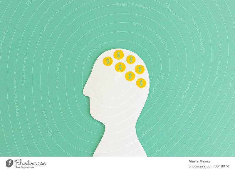 Money in the head | head silhouette of paper with dollar coins Head Neutral Background Brain and nervous system Think Stress Silhouette Human being Bad thoughts
