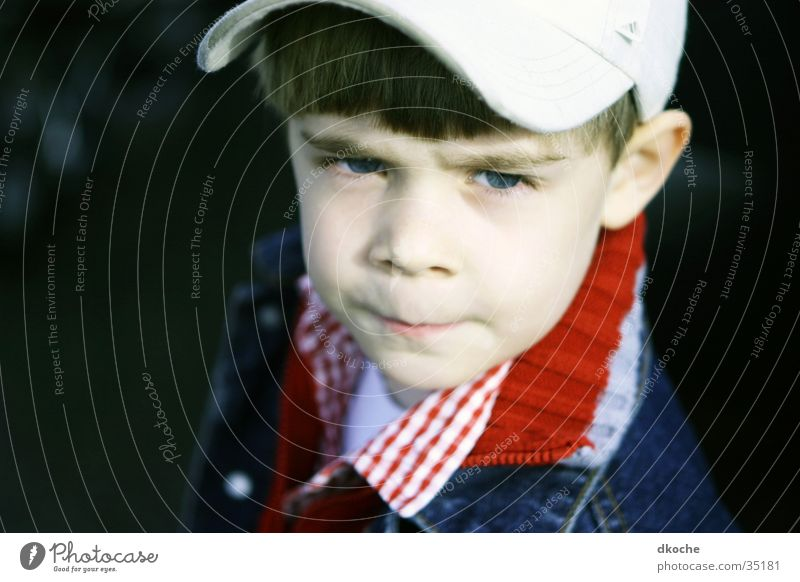 Child Boy (child) Skeptical Clothing Baseball cap