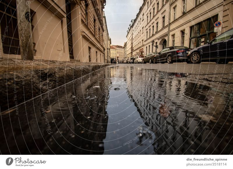 Spandau suburb Berlin Old town Water Puddle reflection Street cars off Sidewalk Reflection Rain Exterior shot Deserted Day Town House (Residential Structure)