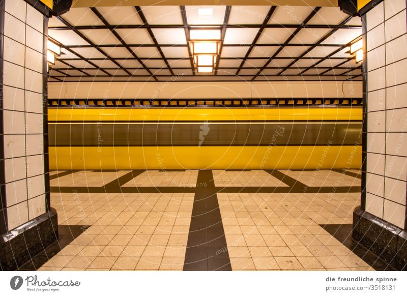 There's a train to nowhere Subway Berlin bvg Train station Town Architecture Capital city Station Long exposure Yellow Symmetry Manmade structures Deserted