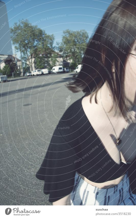 teenager runs out of the picture Youth (Young adults) laterally missed the mark from the picture décolleté Necklace Street Asphalt Parking lot Exterior shot