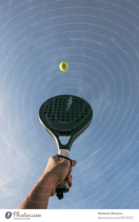 Paddle tennis shot in the air, hand, racket and ball paddle tennis padel isolated close up close-up pádel sport objects sports recreation human hand serve grab