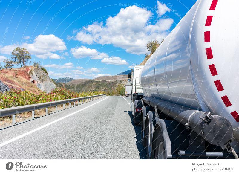 Tanker truck tanker truck dangerous goods fuel liquid transport petroleum oil industry road storage tank diesel supply load ADR trucking on the road semi