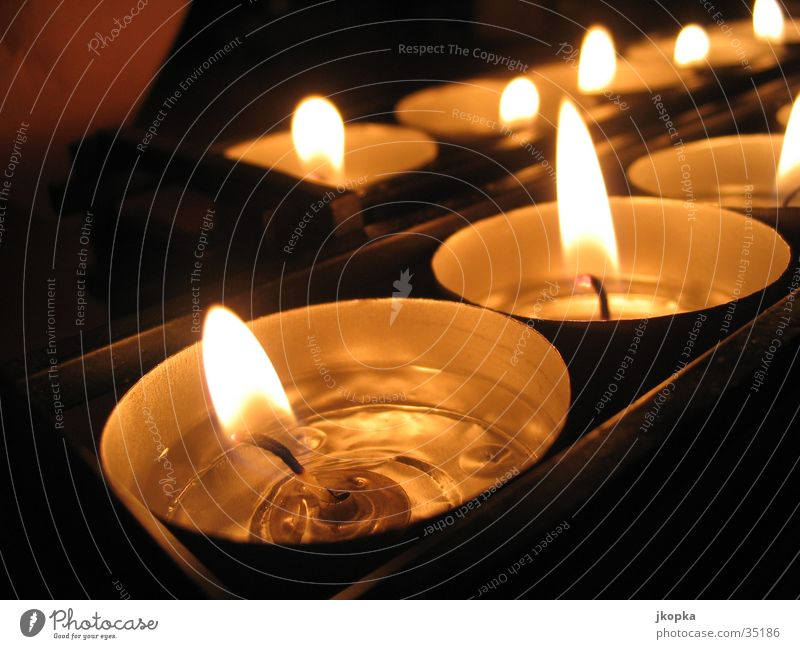 Teelights Decoration Candle Dark Warmth Yellow Black Emotions Moody Romance Tea warmer candle Candlelight Candle flame Burn Warm light Colour photo Detail