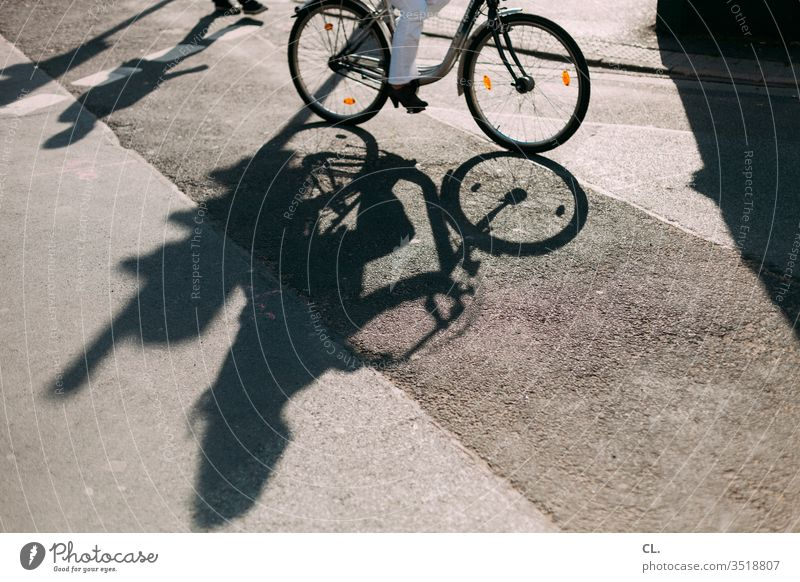 cycling in the city Bicycle Shadow Street Traffic infrastructure Means of transport Transport Cycling Road traffic Lanes & trails Mobility Road safety Town