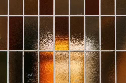 windows Window Window pane Frosted glass Arrangement Glass Structures and shapes Abstract Pattern Line Esthetic Design Yellow Orange Architecture Day Colour