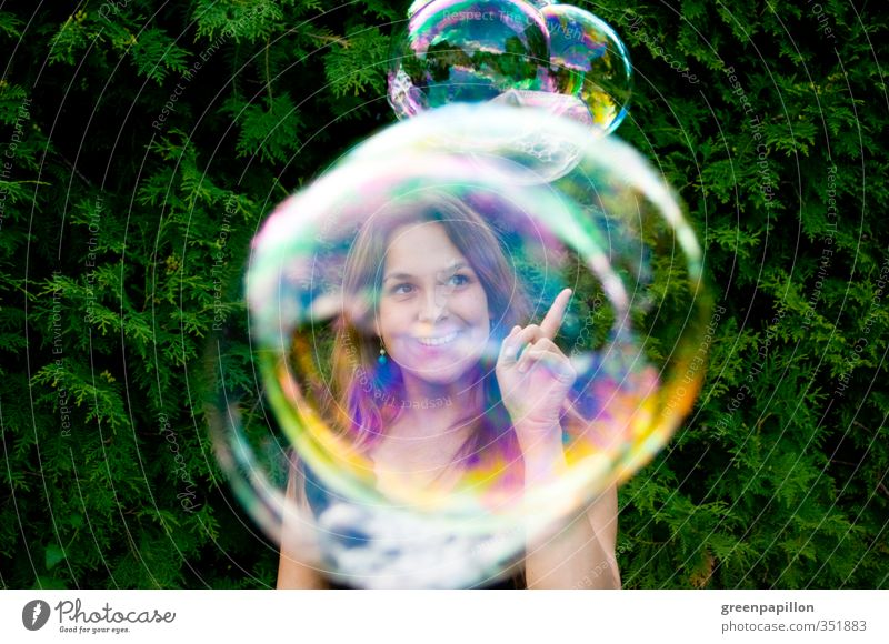 Catch soap bubbles Feminine Young woman Youth (Young adults) Infancy Playing Soap bubble Garden Sphere Blow Bubble Woman Rainbow Prismatic colors Mirror image