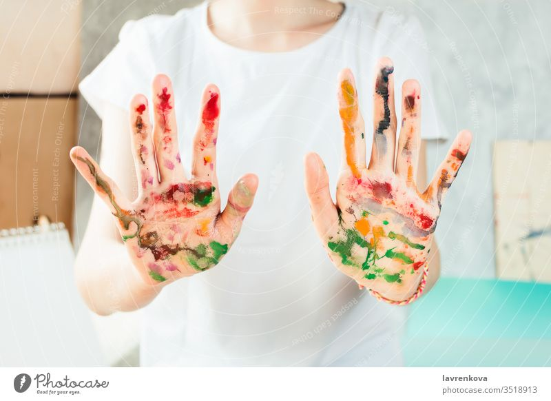 Closeup of woman's hands painted with watercolors girl drawing person artist beautiful closeup colorful creative dye education female festive green hobby job