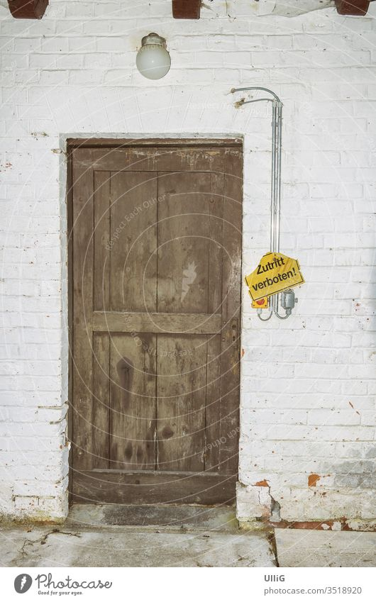 """""""No Entry"""" sign next to the door of an old historic factory building. locked Entrance Facade built Architecture Lamp Light Clue forsake sb./sth. rear entrance"""