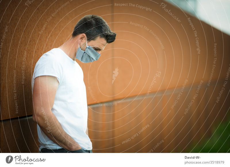 Corona - Thoughtful man with self-made outdoor breathing mask Respirator mask coronavirus Virus Self-made Mask Illness Healthy pandemic Protection Contagious