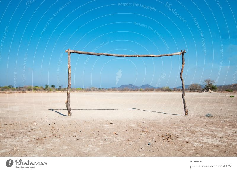 Homemade football goal on a clay court in Africa soccer Soccer Goal Football pitch Sports Sand Zimbabwe game Deserted Ball sports Sporting Complex