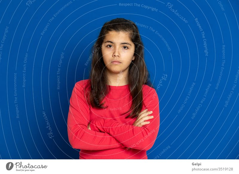 Preteen girl with red t-shirt preteen blue scared surprised horrified emotion gesture worried excited problem portrait expression female people person pretty