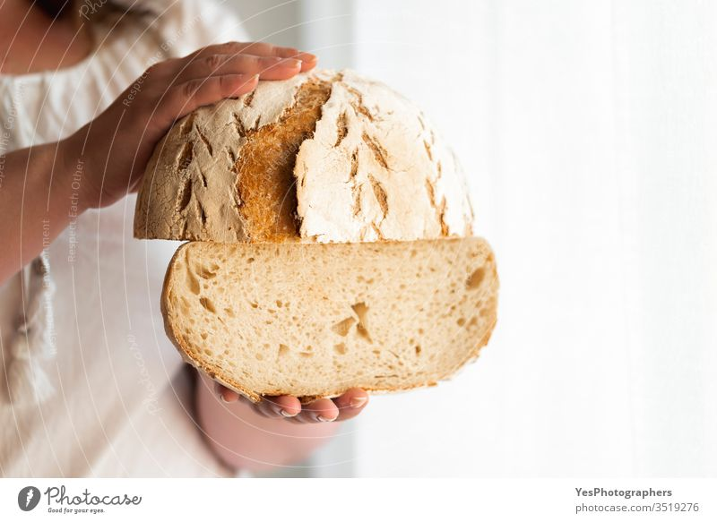 Sourdough bread hold in hands. No yeast bread artisan bread baked goods bakery carbs consumerism crust crusty fermentation food freshly baked golden crust
