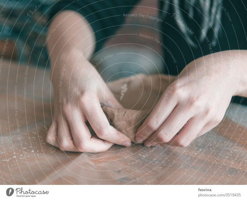 Ceramist hands make a plate of clay brown craft work art ceramic handmade pottery skill workshop culture handicraft hobby traditional wheel artist closeup woman