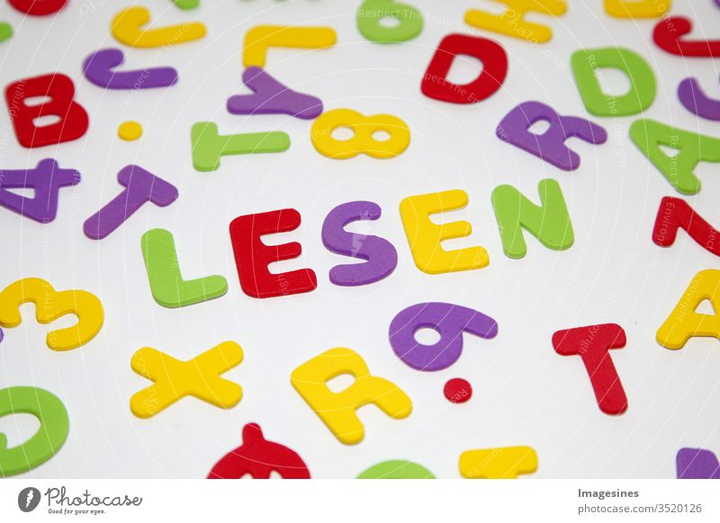 the word READ, patterns with letters of the alphabet and numbers in random order on a white background. Education and Starting School Concept ABC Abstract