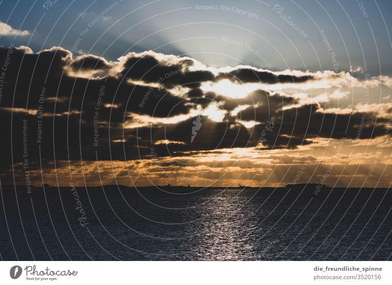 Sunset at the promenade Warnemünde Baltic Sea Sky Clouds Water Lake Ocean Long exposure Colour photo Rostock Exterior shot Mecklenburg-Western Pomerania Nature