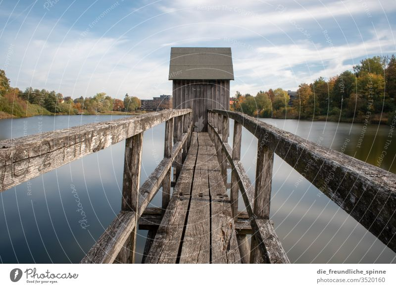 Lift in the Harz Mountains Hahnenklee Lake Long exposure Symmetry huts Autumn Sky Blue colourful Nature Landscape green tree Exterior shot Water Forest Deserted