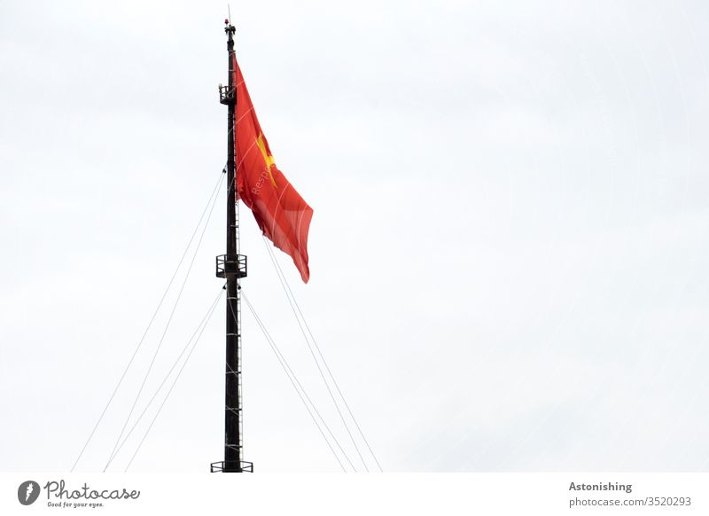 Flagpole with Vietnamese flag, Hue, Vietnam flagpole Sky Red Yellow Textiles ropes Rope Tall great Pole Black Patriotism Day Exterior shot Pride Ensign