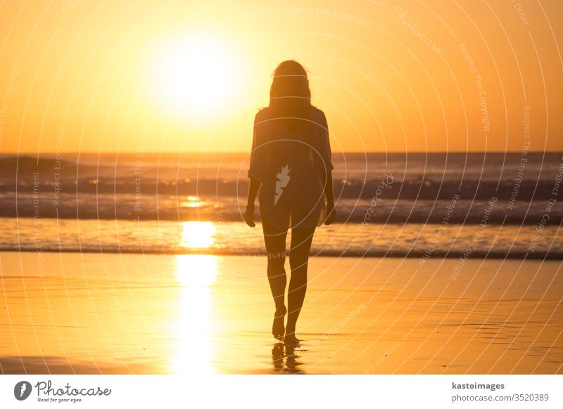 Lady walking on sandy beach in sunset. sea woman summer footprint footstep landscape coastline vacation water nature female waves beautiful ocean barefoot