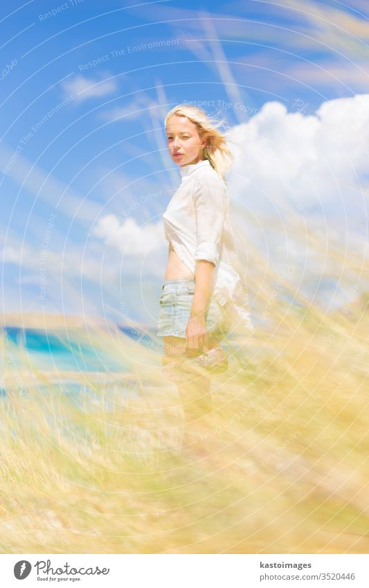 Free Happy Woman Enjoying Sun on Vacations. woman nature free happy summer wind freedom beach young girl beautiful beauty happiness outdoor white sunshine